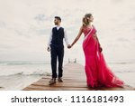 wind blows bride's pink sari... | Shutterstock . vector #1116181493