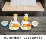 breakfast with hot dogs  fried... | Shutterstock . vector #1116189956
