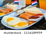 breakfast with hot dogs  fried... | Shutterstock . vector #1116189959