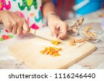 woman cut turmeric on the table | Shutterstock . vector #1116246440
