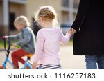 toddler girl looking on the boy ... | Shutterstock . vector #1116257183