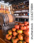Small photo of Tenerife, Canary islands - june 19, 2018: Tomatoes and wine barrels inside a typical tavern in the urban center of the city of La Laguna