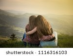 two friends hugging looking at... | Shutterstock . vector #1116316103