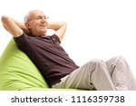 relaxed senior sitting on a... | Shutterstock . vector #1116359738