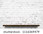 wooden shelf over white brick... | Shutterstock . vector #1116369479