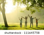 an asian family jumping in joy... | Shutterstock . vector #111645758