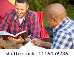 men having a bible study on a... | Shutterstock . vector #1116459236