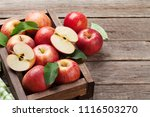 ripe red apples on wooden table.... | Shutterstock . vector #1116503270