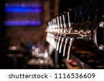 beer tap array from the bar... | Shutterstock . vector #1116536609