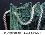 baltic fishing net and rope. | Shutterstock . vector #1116584234