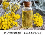 A Bottle Of Essential Oil With...