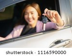 asian driver woman smiling and... | Shutterstock . vector #1116590000