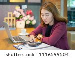 Small photo of calculate,finance,account,bored Business people analyzing investment charts calculator .Accounting technology,using laptop at office,Analyze plans document paper graph chart business marketing plan