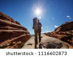 hiker rests in arches national... | Shutterstock . vector #1116602873