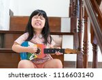 happy funny little asian girl... | Shutterstock . vector #1116603140