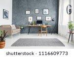 wooden chair at desk in grey... | Shutterstock . vector #1116609773