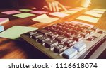 close up calculator with asian...   Shutterstock . vector #1116618074