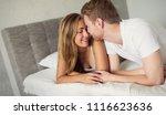 romantic couple in bed | Shutterstock . vector #1116623636
