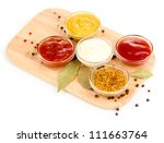 various sauces on chopping... | Shutterstock . vector #111663764
