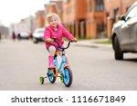 cute little girl learning ride...   Shutterstock . vector #1116671849