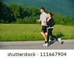 young couple jogging in park at ... | Shutterstock . vector #111667904