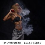 sexy woman smoke electronic... | Shutterstock . vector #1116741869