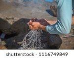 hands of poor man scoop... | Shutterstock . vector #1116749849