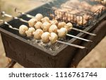 cooking mushrooms and meat on... | Shutterstock . vector #1116761744