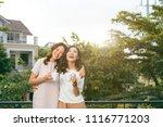two women relaxing on rooftop... | Shutterstock . vector #1116771203