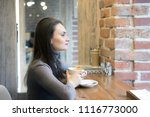 drinking latte. young beautiful ... | Shutterstock . vector #1116773000