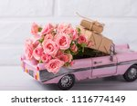 retro car toy with pink roses... | Shutterstock . vector #1116774149