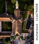 Small photo of Soaring majestic church Saint Maurice in little french village Ebersmunster. Aerial drone view. Alsace. France.