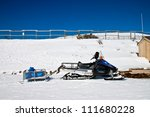 a parked snowmobile in a winter ...   Shutterstock . vector #111680228