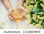 linden tea in the hands of a... | Shutterstock . vector #1116804893