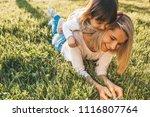 attractive happy young mother... | Shutterstock . vector #1116807764