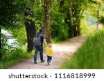 little boy and his father... | Shutterstock . vector #1116818999