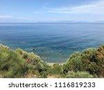 aegean coast  beach and cliffs. ... | Shutterstock . vector #1116819233
