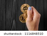gold bitcoin in hands at the... | Shutterstock . vector #1116848510