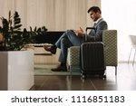 businessman reading a magazine... | Shutterstock . vector #1116851183