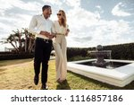 stylish couple walking outdoors ... | Shutterstock . vector #1116857186