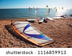 windsurf boards on the sand at... | Shutterstock . vector #1116859913