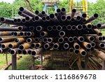 oil drill pipe. rusty drill... | Shutterstock . vector #1116869678