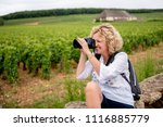 pretty female photographer... | Shutterstock . vector #1116885779