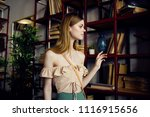 woman looking at books          ... | Shutterstock . vector #1116915656