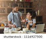 african american couple cooking ... | Shutterstock . vector #1116927500