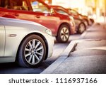 cars moving on the road in city ... | Shutterstock . vector #1116937166