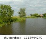 dutch ditch  friesland | Shutterstock . vector #1116944240