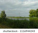 dutch ditch  friesland | Shutterstock . vector #1116944243