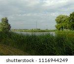 dutch ditch  friesland | Shutterstock . vector #1116944249