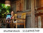 attractive girl sit on open air ... | Shutterstock . vector #1116945749
